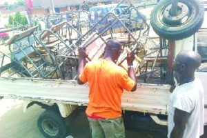 Driver of vehicle loading the chairs donated by Action for Community Development