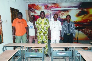 Okhokhugbo Community representatives in ACD Hall to collect the school chair donated to their Community school